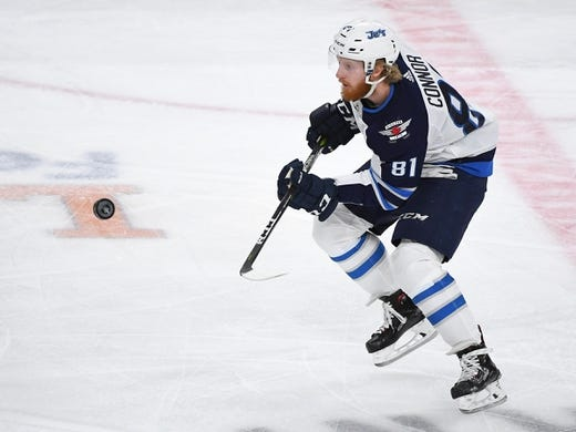 May 16, 2018; Las Vegas, NV, USA; Winnipeg Jets left wing Kyle Connor (81) flips the puck ahead during the first period against the Vegas Golden Knights in game three of the Western Conference Final of the 2018 Stanley Cup Playoffs at T-Mobile Arena. Mandatory Credit: Stephen R. Sylvanie-USA TODAY Sports