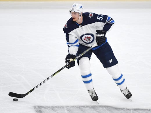 May 16, 2018; Las Vegas, NV, USA; Winnipeg Jets defenseman Tyler Myers (57) skates against the Vegas Golden Knights during the first period of game three of the Western Conference Final of the 2018 Stanley Cup Playoffs at T-Mobile Arena. Mandatory Credit: Stephen R. Sylvanie-USA TODAY Sports