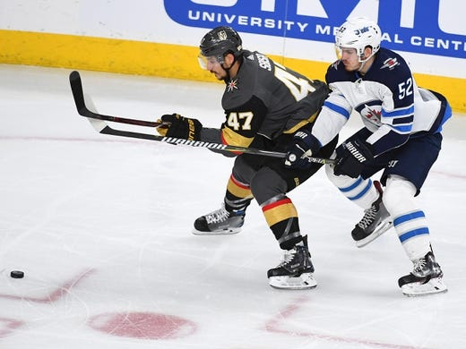 May 16, 2018; Las Vegas, NV, USA; Winnipeg Jets center Jack Roslovic (52) lifts the stick of Vegas Golden Knights defenseman Luca Sbisa (47) during the first period of game three of the Western Conference Final of the 2018 Stanley Cup Playoffs at T-Mobile Arena. Mandatory Credit: Stephen R. Sylvanie-USA TODAY Sports