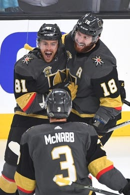May 16, 2018; Las Vegas, NV, USA; Vegas Golden Knights center Jonathan Marchessault (81) celebrates with left wing James Neal (18) and defenseman Brayden McNabb (3) after scoring a first period goal against the Winnipeg Jets in game three of the Western Conference Final of the 2018 Stanley Cup Playoffs at T-Mobile Arena. Mandatory Credit: Stephen R. Sylvanie-USA TODAY Sports