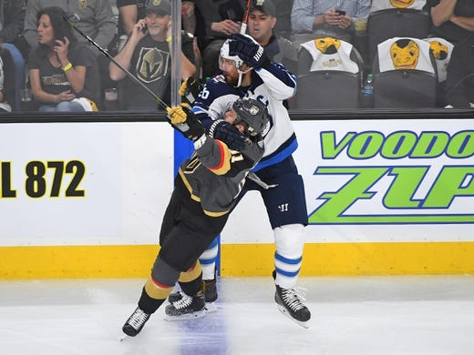 May 16, 2018; Las Vegas, NV, USA; Winnipeg Jets right wing Blake Wheeler (26) against Vegas Golden Knights center Jonathan Marchessault (81) during the first period  of game three of the Western Conference Final of the 2018 Stanley Cup Playoffs at T-Mobile Arena. Mandatory Credit: Stephen R. Sylvanie-USA TODAY Sports