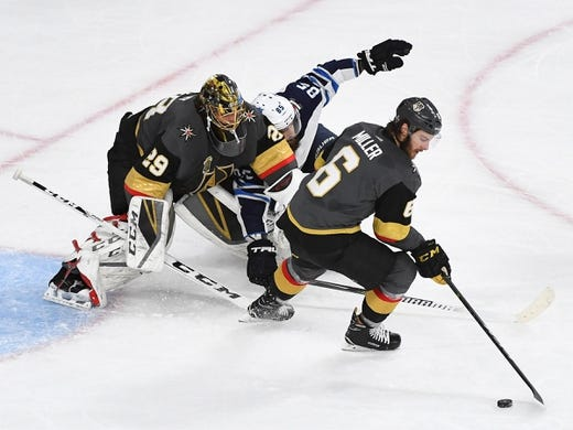 May 16, 2018; Las Vegas, NV, USA; Vegas Golden Knights defenseman Colin Miller (6) intercepts a pass as Vegas Golden Knights goaltender Marc-Andre Fleury (29) holds up Winnipeg Jets center Mathieu Perreault (85) during a first period Jets power play in game three of the Western Conference Final of the 2018 Stanley Cup Playoffs at T-Mobile Arena. Mandatory Credit: Stephen R. Sylvanie-USA TODAY Sports