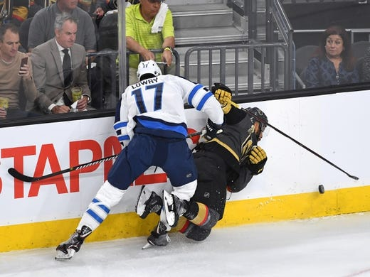 May 16, 2018; Las Vegas, NV, USA; Winnipeg Jets center Adam Lowry (17) checks Vegas Golden Knights left wing Pierre-Edouard Bellemare (41) during the first period of game three of the Western Conference Final of the 2018 Stanley Cup Playoffs at T-Mobile Arena. Mandatory Credit: Stephen R. Sylvanie-USA TODAY Sports