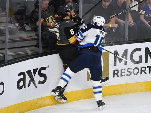 May 16, 2018; Las Vegas, NV, USA; Winnipeg Jets center Bryan Little (18) checks Vegas Golden Knights defenseman Colin Miller (6) during the first period of game three of the Western Conference Final of the 2018 Stanley Cup Playoffs at T-Mobile Arena. Mandatory Credit: Stephen R. Sylvanie-USA TODAY Sports