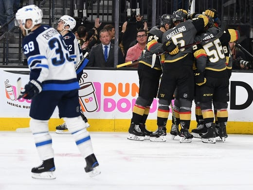 May 16, 2018; Las Vegas, NV, USA; Vegas Golden Knights players celebrate a goal scored by Vegas Golden Knights right wing Alex Tuch (89) in the second period against the Winnipeg Jets in game three of the Western Conference Final of the 2018 Stanley Cup Playoffs at T-Mobile Arena. Mandatory Credit: Stephen R. Sylvanie-USA TODAY Sports