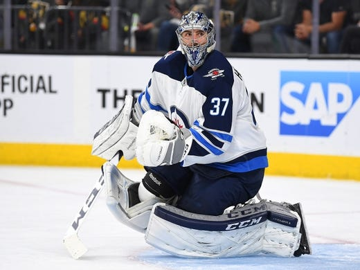 May 16, 2018; Las Vegas, NV, USA; Winnipeg Jets goaltender Connor Hellebuyck (37) watches play during the second period against the Vegas Golden Knights in game three of the Western Conference Final of the 2018 Stanley Cup Playoffs at T-Mobile Arena. Mandatory Credit: Stephen R. Sylvanie-USA TODAY Sports