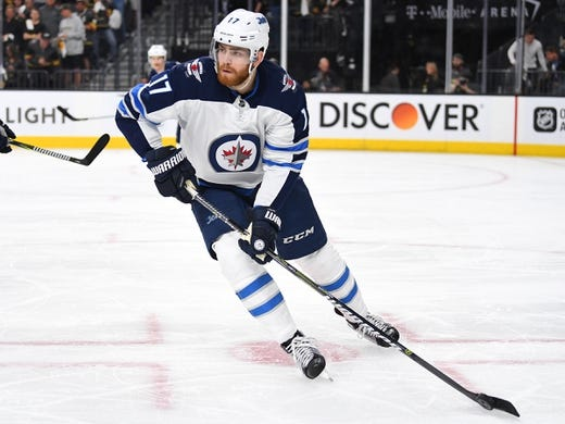 May 16, 2018; Las Vegas, NV, USA; Winnipeg Jets center Adam Lowry (17) skates against the Vegas Golden Knights during the second period of game three of the Western Conference Final of the 2018 Stanley Cup Playoffs at T-Mobile Arena. Mandatory Credit: Stephen R. Sylvanie-USA TODAY Sports