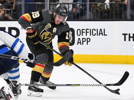 May 16, 2018; Las Vegas, NV, USA; Vegas Golden Knights right wing Reilly Smith (19) lifts a backhand shot towards the Winnipeg net during the second period of game three of the Western Conference Final of the 2018 Stanley Cup Playoffs at T-Mobile Arena. Mandatory Credit: Stephen R. Sylvanie-USA TODAY Sports