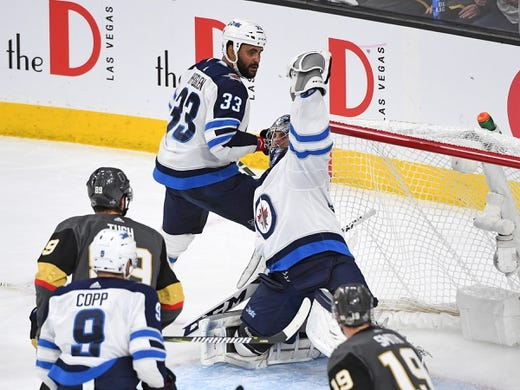 May 16, 2018; Las Vegas, NV, USA; Winnipeg Jets goaltender Connor Hellebuyck (37) makes a first period glove save against the Vegas Golden Knights in game three of the Western Conference Final of the 2018 Stanley Cup Playoffs at T-Mobile Arena. Mandatory Credit: Stephen R. Sylvanie-USA TODAY Sports
