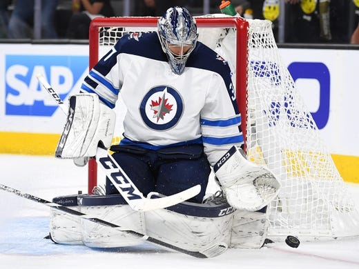 May 16, 2018; Las Vegas, NV, USA; Winnipeg Jets goaltender Connor Hellebuyck (37) makes a second period save against the Vegas Golden Knights in game three of the Western Conference Final of the 2018 Stanley Cup Playoffs at T-Mobile Arena. Mandatory Credit: Stephen R. Sylvanie-USA TODAY Sports