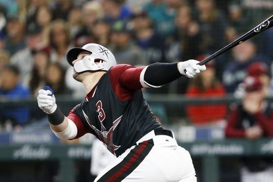 Jun 30, 2018; Seattle, WA, USA; Seattle Mariners catcher Mike Zunino (3) hits an RBI sacrifice fly against the Kansas City Royals during the second inning at Safeco Field. Mandatory Credit: Joe Nicholson-USA TODAY Sports