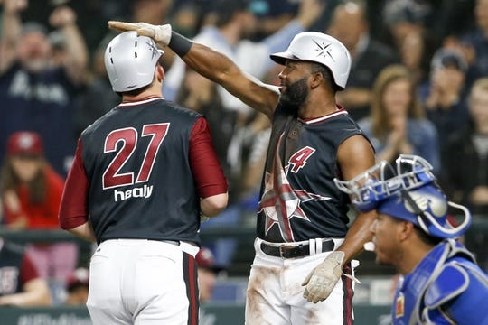 Jun 30, 2018; Seattle, WA, USA; Seattle Mariners first baseman Ryon Healy (27) is greeted by left fielder Denard Span (4) after hitting a two-run home run against the Kansas City Royals during the second inning at Safeco Field. Span scored on the hit. Mandatory Credit: Joe Nicholson-USA TODAY Sports
