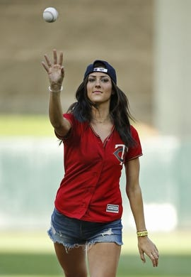 Jul 10, 2018; Minneapolis, MN, USA; From TV's the Bachelorette, Becca Kufrin throws out a ceremonial pitch before the game between the Kansas City Royals and the Minnesota Twins at Target Field. Mandatory Credit: Bruce Kluckhohn-USA TODAY Sports