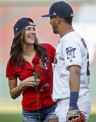 Jul 10, 2018; Minneapolis, MN, USA; Actress from the TV show The Bachelorette Becca Kufrin celebrates after throwing out the ceremonial first pitch with Minnesota Twins left fielder Eddie Rosario (20) who brought her a rose before the game against the Kansas City Royals at Target Field. Mandatory Credit: Bruce Kluckhohn-USA TODAY Sports