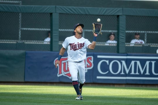 Jul 10, 2018; Minneapolis, MN, USA; Minnesota Twins left fielder Eddie Rosario (20) fields a ball hit by the Kansas City Royals in the first inning at Target Field. Mandatory Credit: Bruce Kluckhohn-USA TODAY Sports