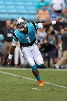 Aug 17, 2018; Charlotte, NC, USA;Carolina Panthers quarterback Cam Newton (1) runs out for warm ups before  the first quarter against the Miami Dolphins at Bank of America Stadium. Mandatory Credit: Jim Dedmon-USA TODAY Sports