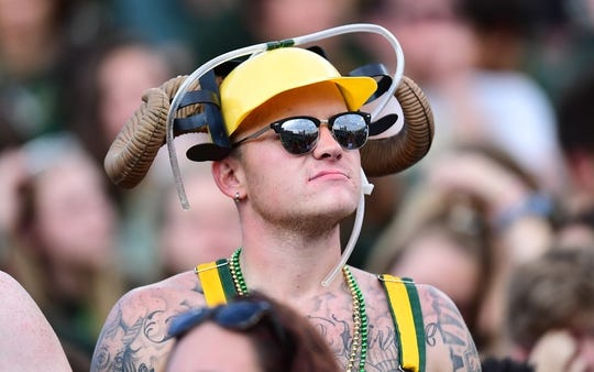 Aug 25, 2018; Fort Collins, CO, USA; A Colorado State Rams fan looks on during the first quarter against the Hawaii Warriors at Canvas Stadium. Mandatory Credit: Ron Chenoy-USA TODAY Sports
