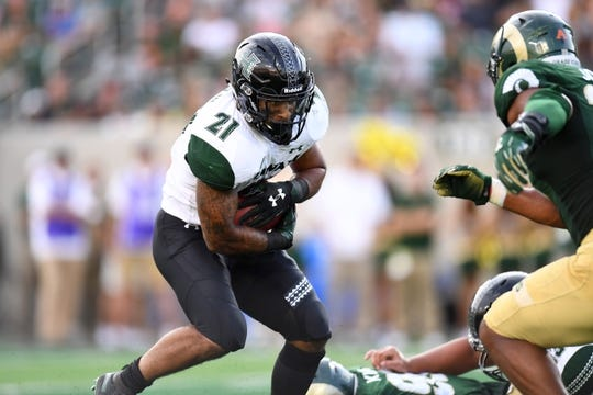 Aug 25, 2018; Fort Collins, CO, USA; Hawaii Warriors running back Fred Holly III (21) carries the ball in the first quarter against the Colorado State Rams at Canvas Stadium. Mandatory Credit: Ron Chenoy-USA TODAY Sports