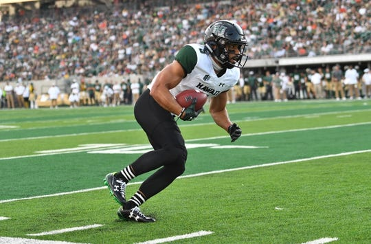 Aug 25, 2018; Fort Collins, CO, USA; Hawaii Warriors wide receiver John Ursua (5) runs after a reception in the first quarter against the Colorado State Rams at Canvas Stadium. Mandatory Credit: Ron Chenoy-USA TODAY Sports