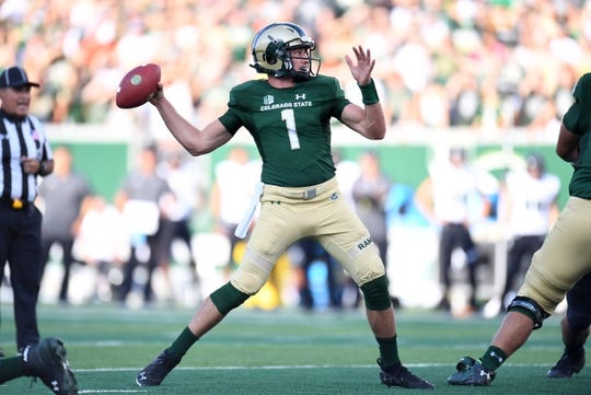 Aug 25, 2018; Fort Collins, CO, USA; Colorado State Rams quarterback K.J. Carta-Samuels (1) attempts a pass in the first quarter against the Hawaii Warriors at Canvas Stadium. Mandatory Credit: Ron Chenoy-USA TODAY Sports