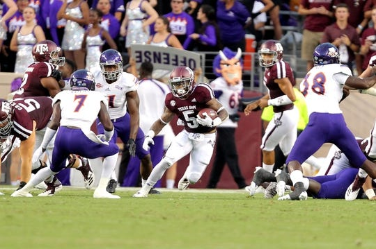 Aug 30, 2018; College Station, TX, USA; Texas A&M Aggies running back Trayveon Williams (5) carries the ball against the Northwestern State Demons during the first quarter at Kyle Field. Mandatory Credit: Erik Williams-USA TODAY Sports