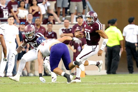 Aug 30, 2018; College Station, TX, USA; Texas A&M Aggies quarterback Kellen Mond (11) carries the ball against the Northwestern State Demons during the first quarter at Kyle Field. Mandatory Credit: Erik Williams-USA TODAY Sports