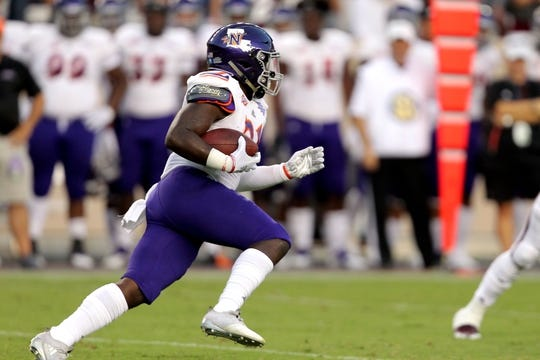 Aug 30, 2018; College Station, TX, USA; Northwestern State Demons running back Jared West (21) carries the ball against the Texas A&M Aggies during the first quarter at Kyle Field. Mandatory Credit: Erik Williams-USA TODAY Sports