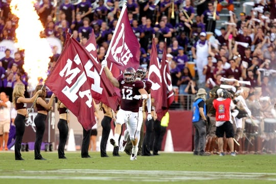 Aug 30, 2018; College Station, TX, USA; Texas A&M Aggies fullback Cullen Gillaspia (12) carries the team flag onto the field during the team introductions prior to the game against the Northwestern State Demons at Kyle Field. Mandatory Credit: Erik Williams-USA TODAY Sports
