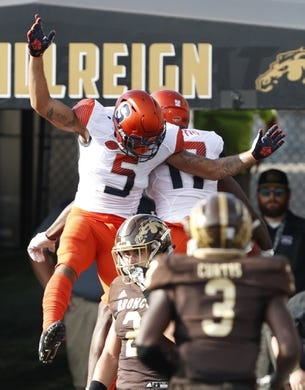 Aug 31, 2018; Kalamazoo, MI, USA; Syracuse Orange wide receiver Jamal Custis (17) celebrates with wide receiver Devin C. Butler (5) after scoring a touchdown during the first quarter against the Western Michigan Broncos at Waldo Stadium. Mandatory Credit: Raj Mehta-USA TODAY Sports
