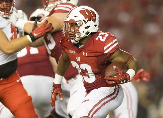 Aug 31, 2018; Madison, WI, USA; Wisconsin Badgers running back Jonathan Taylor (23) rushes with the football during the first quarter against the Western Kentucky Hilltoppers at Camp Randall Stadium. Mandatory Credit: Jeff Hanisch-USA TODAY Sports