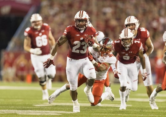 Aug 31, 2018; Madison, WI, USA; Wisconsin Badgers running back Jonathan Taylor (23) rushes for a touchdown during the first quarter against the Western Kentucky Hilltoppers at Camp Randall Stadium. Mandatory Credit: Jeff Hanisch-USA TODAY Sports