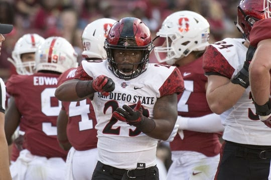 August 31, 2018; Stanford, CA, USA; San Diego State Aztecs running back Juwan Washington (29) celebrates after scoring a touchdown against the Stanford Cardinal during the first quarter at Stanford Stadium. Mandatory Credit: Kyle Terada-USA TODAY Sports