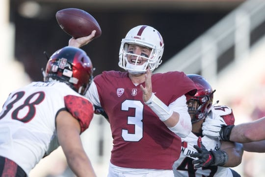 August 31, 2018; Stanford, CA, USA; Stanford Cardinal quarterback K.J. Costello (3) passes the football against San Diego State Aztecs linebacker Andrew Aleki (38) during the first quarter at Stanford Stadium. Mandatory Credit: Kyle Terada-USA TODAY Sports