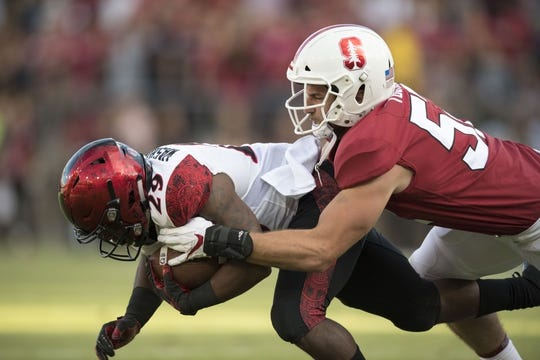 August 31, 2018; Stanford, CA, USA; San Diego State Aztecs running back Juwan Washington (29) is tackled by Stanford Cardinal linebacker Casey Toohill (52) during the first quarter at Stanford Stadium. Mandatory Credit: Kyle Terada-USA TODAY Sports