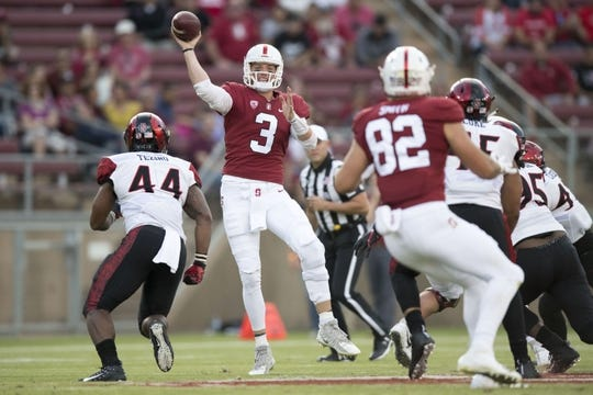 August 31, 2018; Stanford, CA, USA; Stanford Cardinal quarterback K.J. Costello (3) passes the football to tight end Kaden Smith (82) against San Diego State Aztecs linebacker Kyahva Tezino (44) during the second quarter at Stanford Stadium. Mandatory Credit: Kyle Terada-USA TODAY Sports