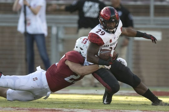 August 31, 2018; Stanford, CA, USA; San Diego State Aztecs running back Juwan Washington (29) is tackled by Stanford Cardinal linebacker Sean Barton (27) during the first quarter at Stanford Stadium. Mandatory Credit: Kyle Terada-USA TODAY Sports