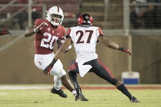 August 31, 2018; Stanford, CA, USA; Stanford Cardinal running back Bryce Love (20) runs against San Diego State Aztecs cornerback Kyree Woods (27) during the third quarter at Stanford Stadium. Stanford defeated San Diego State 31-10. Mandatory Credit: Kyle Terada-USA TODAY Sports