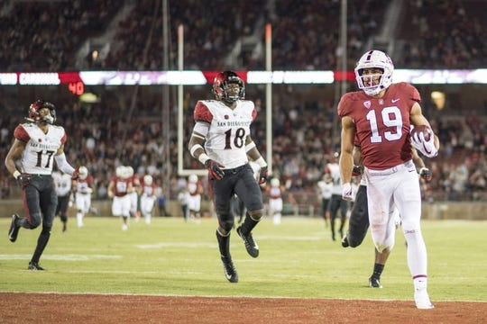 August 31, 2018; Stanford, CA, USA; Stanford Cardinal wide receiver Jj Arcega-Whiteside (19) scores a touchdown against the San Diego State Aztecs during the third quarter at Stanford Stadium. Stanford defeated San Diego State 31-10. Mandatory Credit: Kyle Terada-USA TODAY Sports