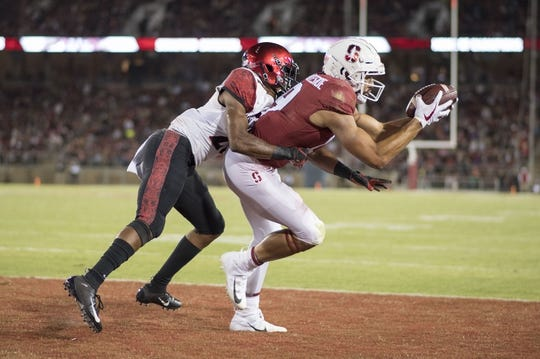 August 31, 2018; Stanford, CA, USA; Stanford Cardinal wide receiver Jj Arcega-Whiteside (19) scores a two-point conversion against San Diego State Aztecs cornerback Kyree Woods (27) during the third quarter at Stanford Stadium. Stanford defeated San Diego State 31-10. Mandatory Credit: Kyle Terada-USA TODAY Sports