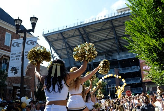 Sep 1, 2018; Atlanta, GA, USA; Georgia Tech cheerleaders walk to the stadium prior to the game against the Alcorn State Braves at Bobby Dodd Stadium. Mandatory Credit: Adam Hagy-USA TODAY Sports