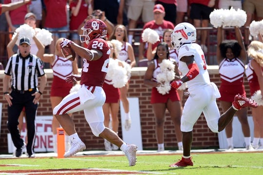 Sep 1, 2018; Norman, OK, USA; Oklahoma Sooners running back Rodney Anderson (24) scores a touchdown in front of Florida Atlantic Owls cornerback Shelton Lewis (3) during the second quarter at Gaylord Family - Oklahoma Memorial Stadium. Mandatory Credit: Mark D. Smith-USA TODAY Sports
