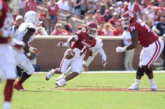 Sep 1, 2018; Norman, OK, USA; Oklahoma Sooners quarterback Kyler Murray (1) scrambles out of the pocket against the Florida Atlantic Owls during the first quarter at Gaylord Family - Oklahoma Memorial Stadium. Mandatory Credit: Mark D. Smith-USA TODAY Sports