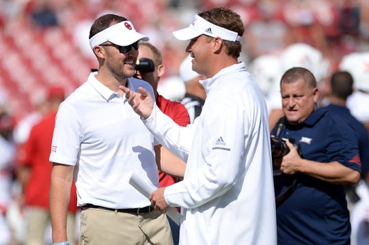 Sep 1, 2018; Norman, OK, USA; Oklahoma Sooners head coach Lincoln Riley (left) greets Florida Atlantic Owls head coach Lane Kiffin prior to action at Gaylord Family - Oklahoma Memorial Stadium. Mandatory Credit: Mark D. Smith-USA TODAY Sports