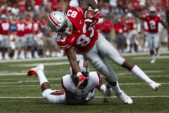 Sep 1, 2018; Columbus, OH, USA; Ohio State Buckeyes wide receiver Terry McLaurin (83) is tackled by Oregon State Beavers cornerback Dwayne Williams (4) in the first half at Ohio Stadium. Mandatory Credit: Rick Osentoski-USA TODAY Sports.