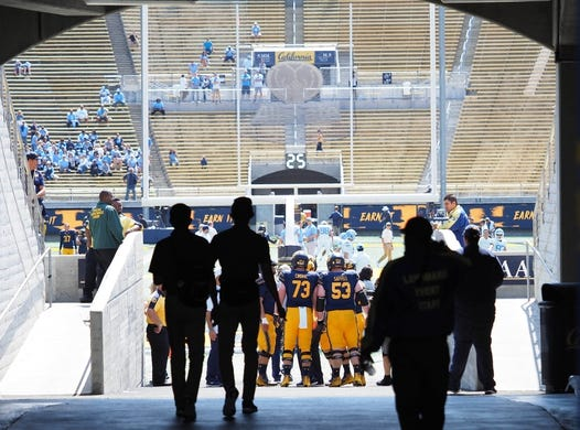 Sep 1, 2018; Berkeley, CA, USA; California Golden Bears players and staff walk onto the field before the game against the North Carolina Tar Heels at California Memorial Stadium. Mandatory Credit: Kelley L Cox-USA TODAY Sports