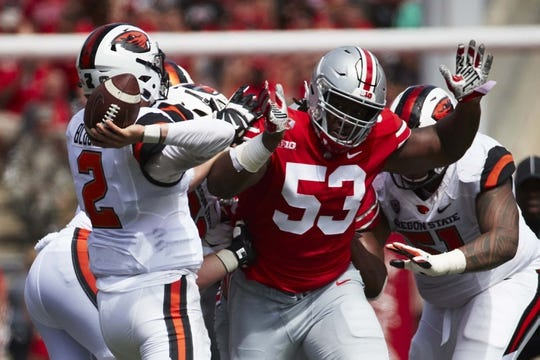 Sep 1, 2018; Columbus, OH, USA; Ohio State Buckeyes defensive tackle Davon Hamilton (53) rushes at Oregon State Beavers quarterback Conor Blount (2) in the first half at Ohio Stadium. Mandatory Credit: Rick Osentoski-USA TODAY Sports