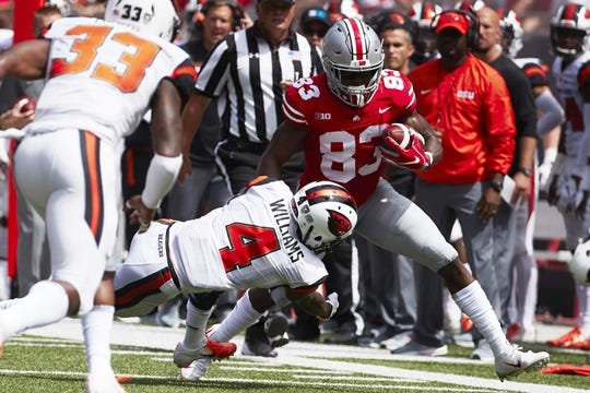 Sep 1, 2018; Columbus, OH, USA; Oregon State Beavers cornerback Dwayne Williams (4) tackles Ohio State Buckeyes wide receiver Terry McLaurin (83) in the first half at Ohio Stadium. Mandatory Credit: Rick Osentoski-USA TODAY Sports