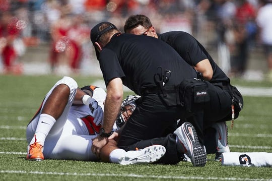 Sep 1, 2018; Columbus, OH, USA; Oregon State Beavers quarterback Conor Blount (2) is tended by medical staff during the first half against the Ohio State Buckeyes at Ohio Stadium. Mandatory Credit: Rick Osentoski-USA TODAY Sports