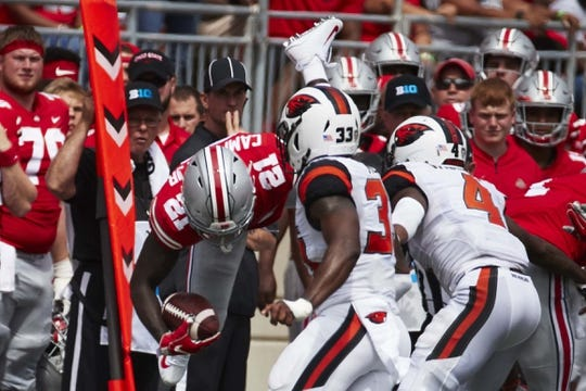 Sep 1, 2018; Columbus, OH, USA; Ohio State Buckeyes wide receiver Parris Campbell (21) is upended during the first half against the Oregon State Beavers at Ohio Stadium. Mandatory Credit: Rick Osentoski-USA TODAY Sports