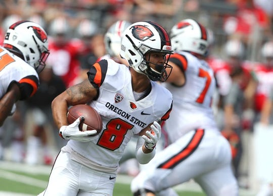 Sep 1, 2018; Columbus, OH, USA; Oregon State Beavers wide receiver Trevon Bradford (8) takes the sweep during the first quarter against the Ohio State Buckeyes at Ohio Stadium. Mandatory Credit: Joe Maiorana-USA TODAY Sports